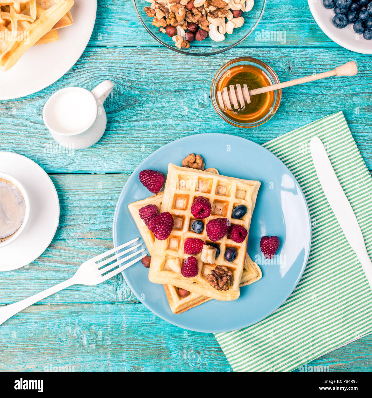 Homemade waffles with raspberries and blueberry - Stock Image