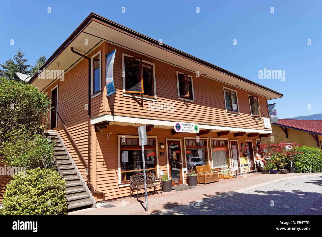 Wooden building with businesses  in Artisan Square on Bowen Island near Vancouver, British Columbia, Canada - Stock Image