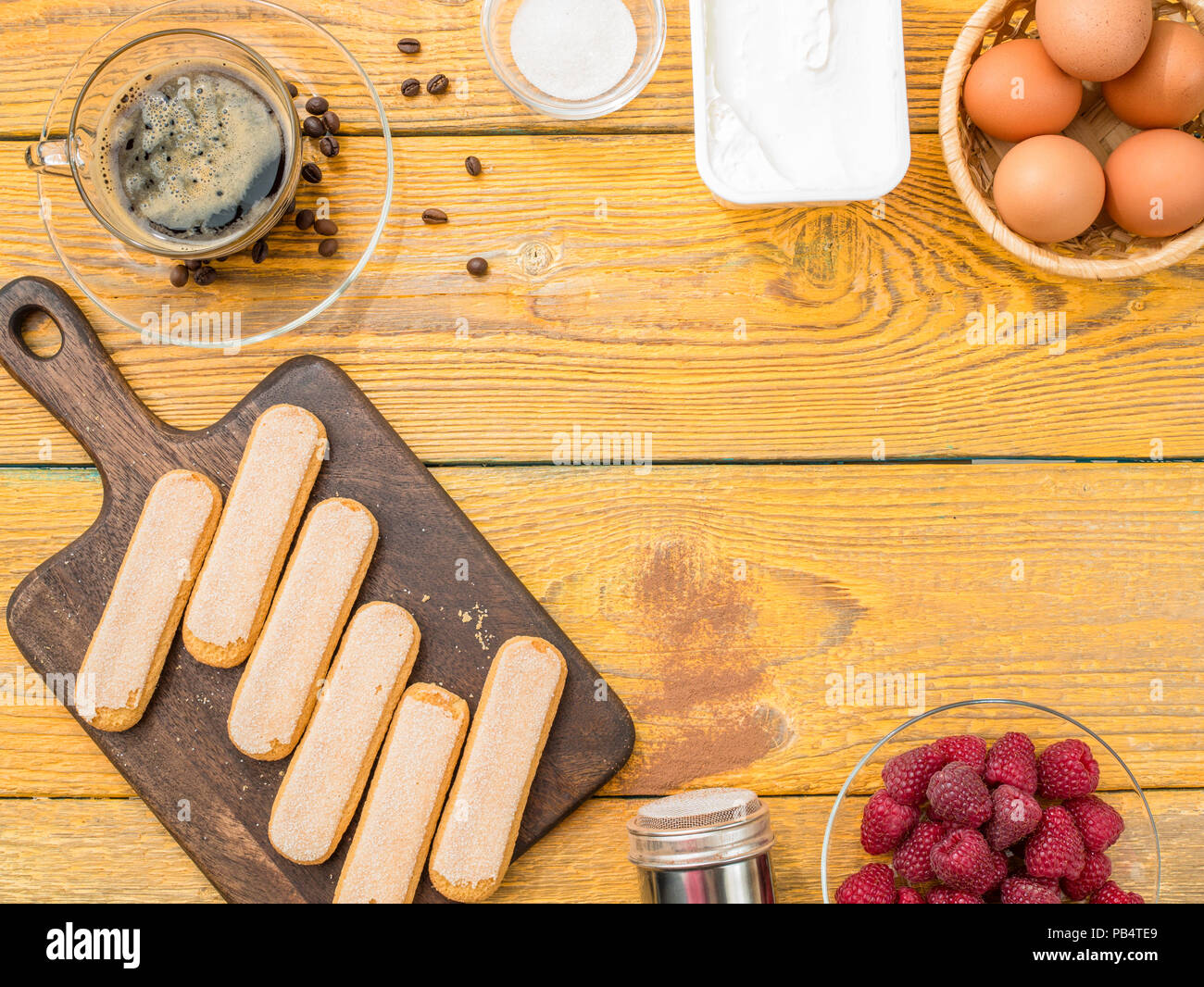 Photo on top of table with biscuits, eggs, raspberries - Stock Image