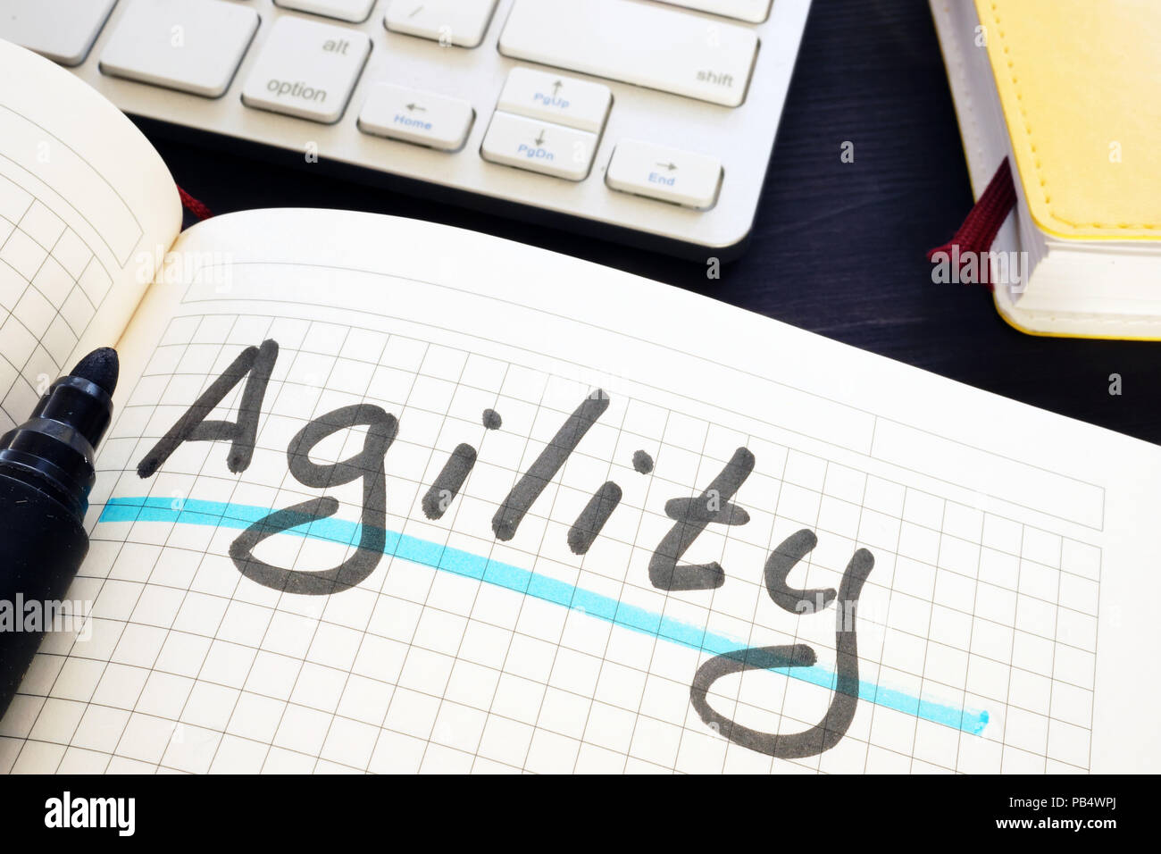 Agility written by hand in a note. - Stock Image
