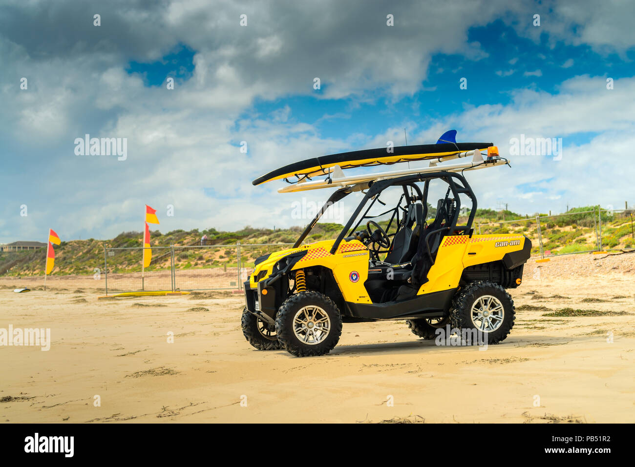 Adelaide, Australia - February 18, 2017: Australian surf life saving rescue car parked on the shores of Sellicks Beach on a day - Stock Image