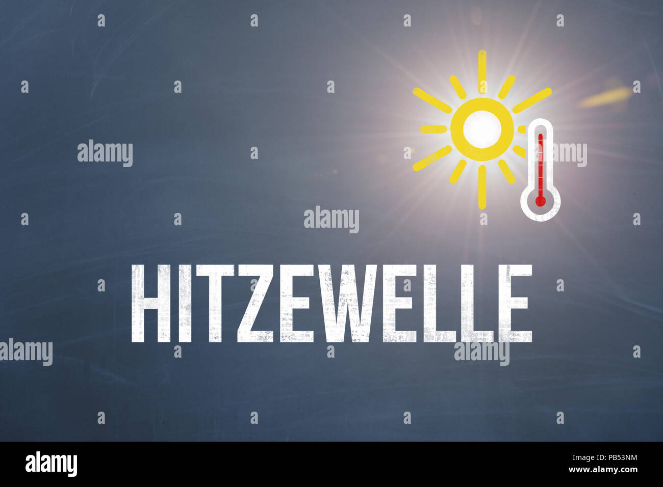 Extreme heat wave written in german with sun and thermometer during the summer of the century 2018 with blue background as template - Stock Image