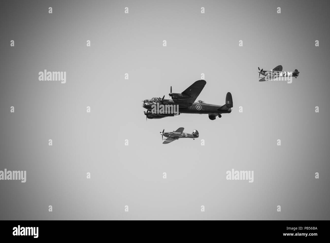 A WW2 Lancaster Bomber accompanied by a Spitfire and Hurricane - Stock Image