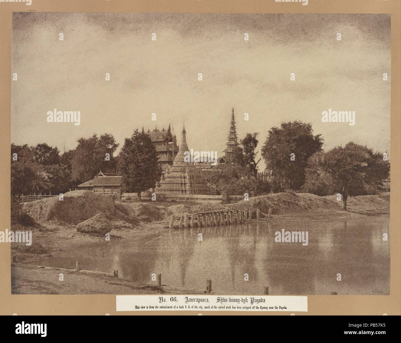 Amerapoora: Shwe-doung-dyk Pagoda. Artist: Linnaeus Tripe (British, Devonport (Plymouth Dock) 1822-1902 Devonport). Dimensions: Image: 25.8 x 34.6 cm (10 3/16 x 13 5/8 in.)  Mount: 45.5 x 58.3 cm (17 15/16 x 22 15/16 in.)  Mat: 20 × 24 in. (50.8 × 61 cm). Date: September 1-October 21, 1855.  Tripe retouched most of his negatives made in Burma and India. Here he painted the banks of clouds on the negative and even added horizontal strokes in the foreground to suggest ripples on the water, possibly to compensate for numerous pinholes in the negative that caused a peppering of black dots scattere Stock Photo