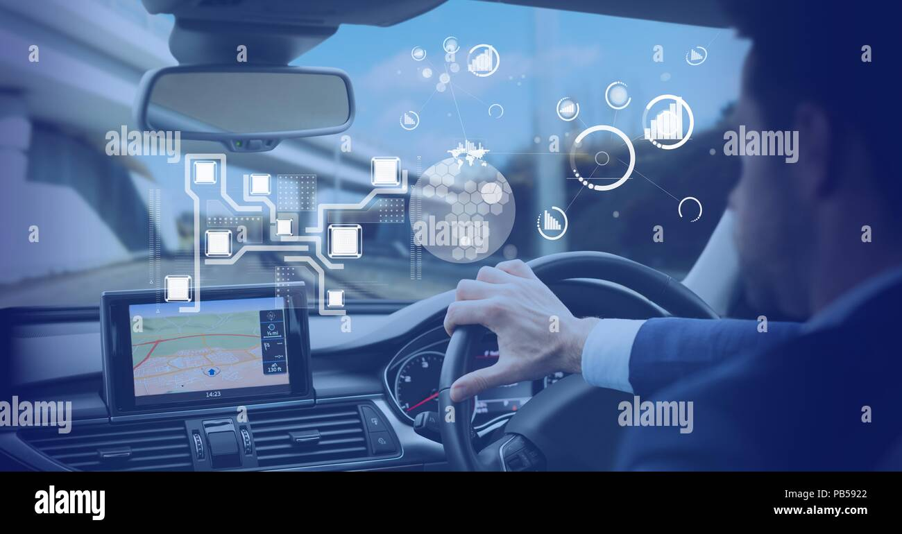 Man driving in car with heads up display interface - Stock Image