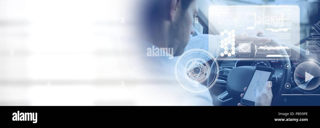 Man driving in car with heads up display interface  and phone and transition - Stock Image