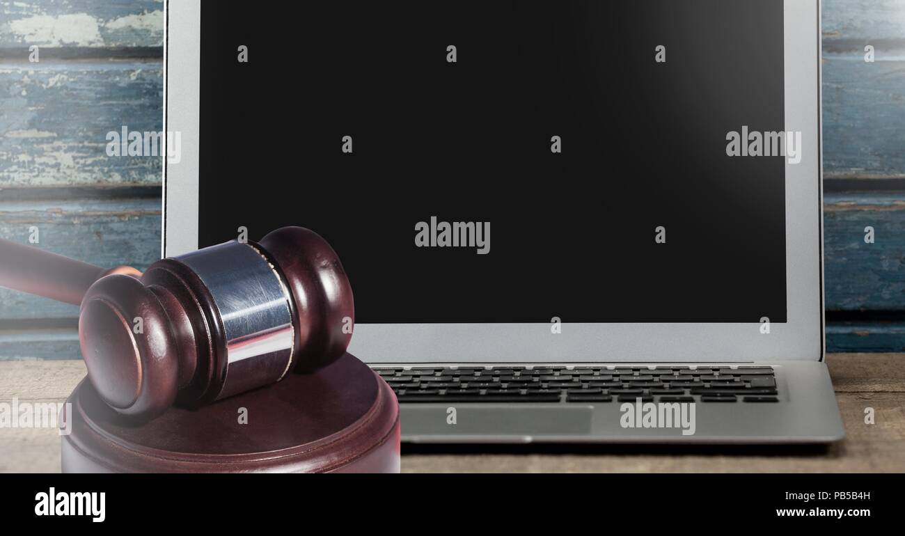 Gavel and laptop on desk Stock Photo