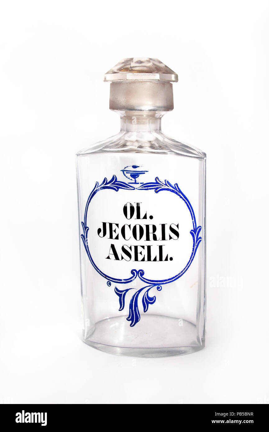 Pharmaceutical glass bottle labeled chemical compounds Ol Jecoris Asell with a white background - Stock Image
