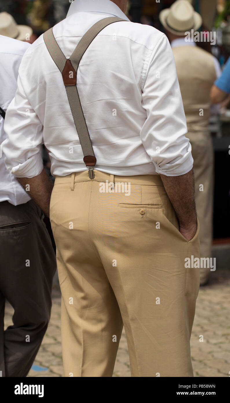 Rear view of a man wearing suspenders - Stock Image