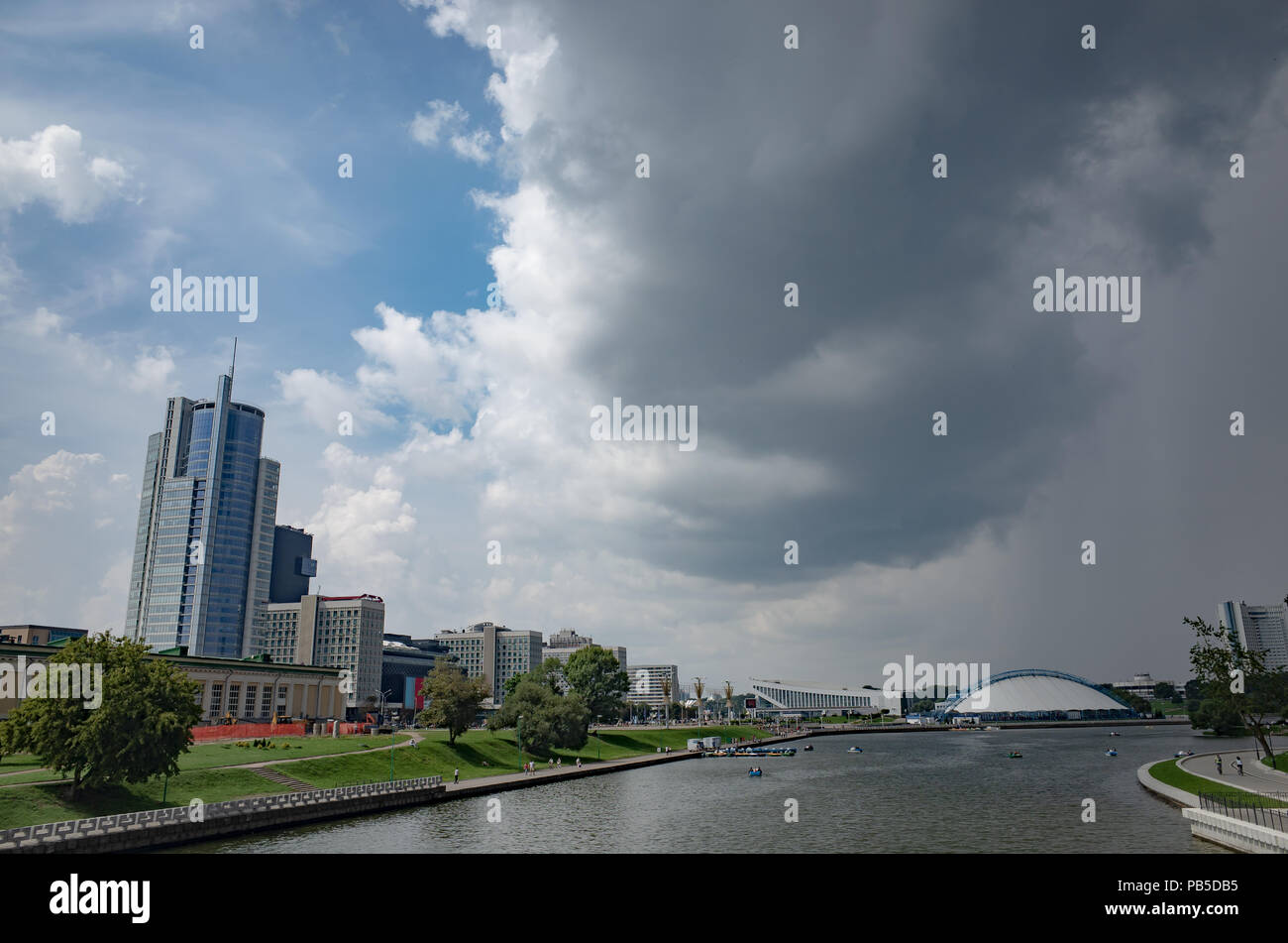 City center. Minsk is the capital of Belarus. Embankment of the Svisloch River. Palace of Sports. - Stock Image