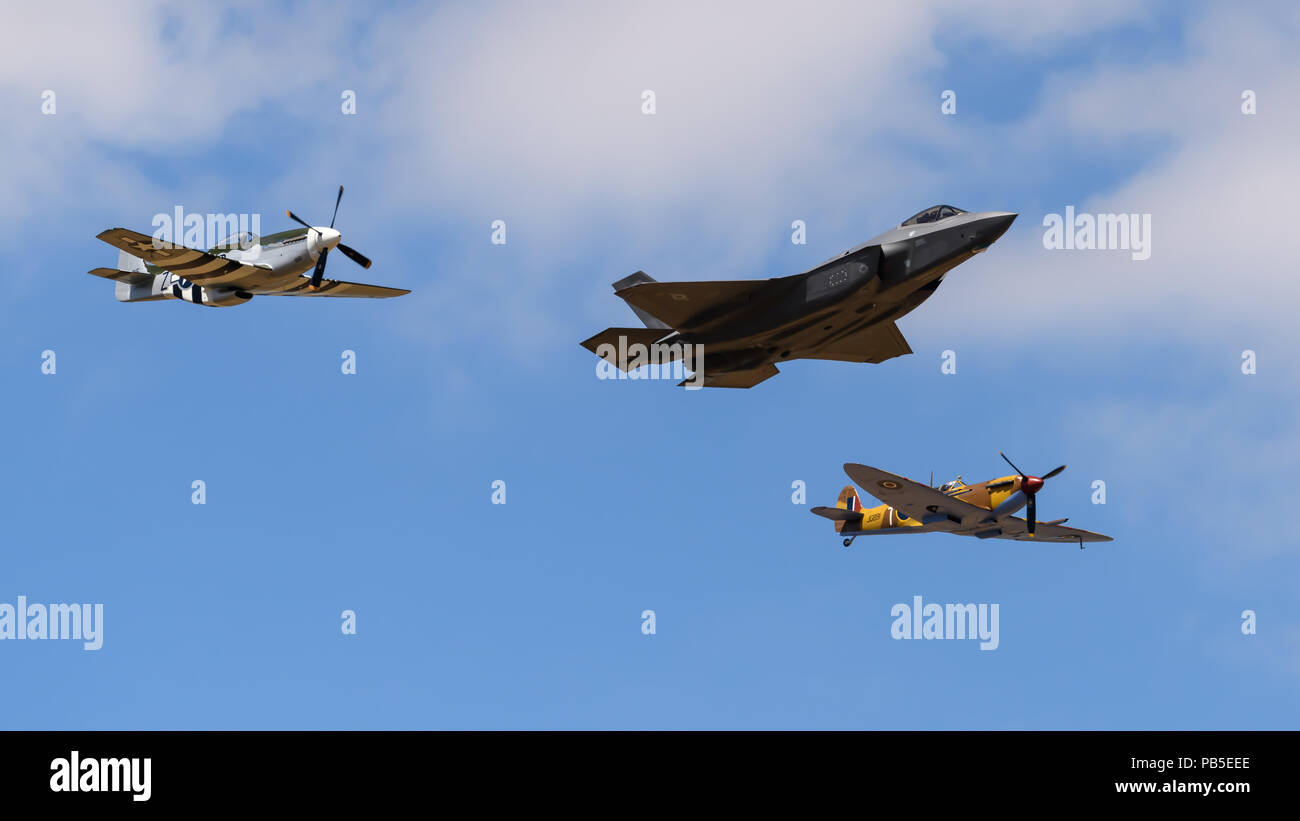 F35 stealth aircraft in formation with Spitfire and Mustang fighters at the Royal International Air Tattoo - Stock Image