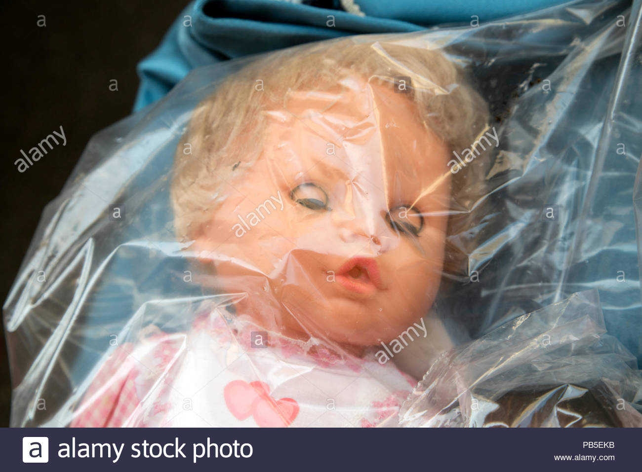 doll in clear plastic bag Stock Photo