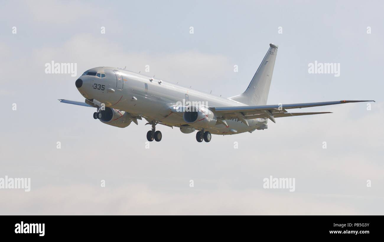 U.S Navy Boeing P-8A Poseidon with it's undercarriage down approaching RAF Fairford for the 2018 Royal International Air Tattoo - Stock Image