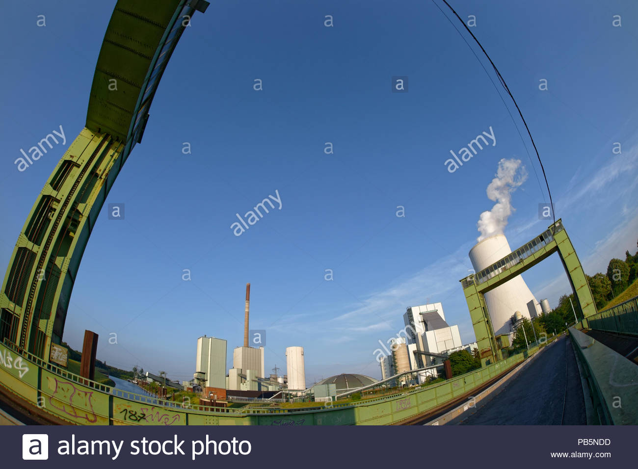 Duisburg-Walsum disused lift bridge inlet coal harbour historic industrial heritage monument STEAG EVN coal fired power station cooling tower steam - Stock Image