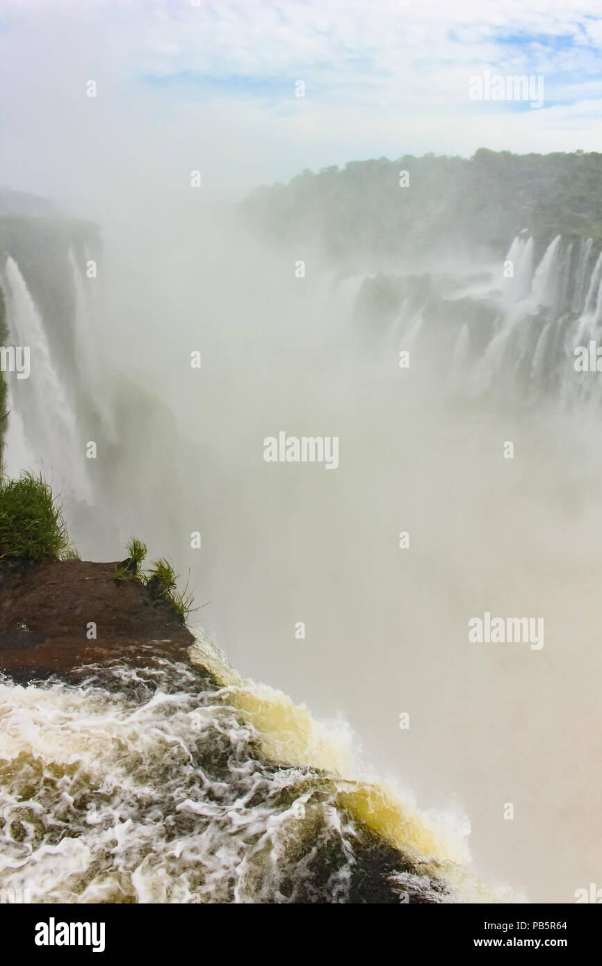 La Garganta Del Diabo translated to The Devil's Throat waterfalls at the highest flow of Iguazu Falls in Argentina, South America - Stock Image