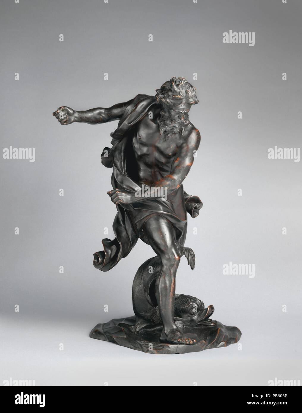 Neptune with a Dolphin. Artist: After a model by Gian Lorenzo Bernini (Italian, Naples 1598-1680 Rome). Culture: Italian. Dimensions: Overall (confirmed): 20 1/4 × 15 3/8 × 11 3/4 in. (51.4 × 39.1 × 29.8 cm). Date: 17th century.  Bernini's marble original, of which this bronze is a variant and not a copy, is in the collection of the Earl of Yarborough, England. Only one bronze variant aside from the Metropolitan's piece has been published. Museum: Metropolitan Museum of Art, New York, USA. - Stock Image