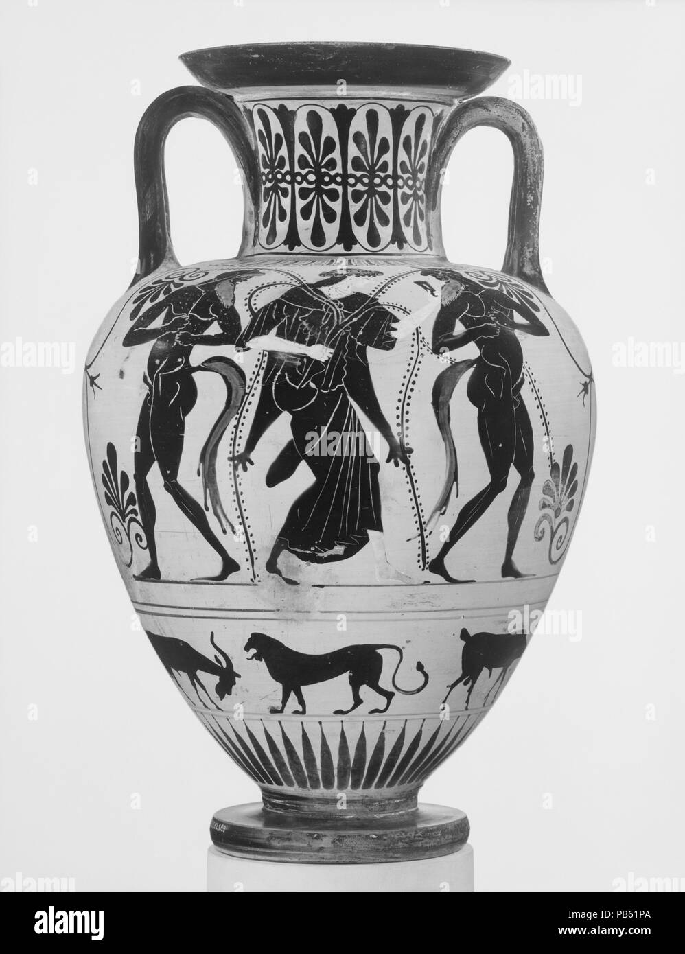 Terracotta neck-amphora (jar). Culture: Greek, Attic. Dimensions: H. 16 5/8 in. (42.2 cm); diameter  10 3/4 in. (27.3 cm). Date: ca. 490 B.C..  Obverse, warrior departing  Reverse, satyrs and maenad  Although the Kleophrades Painter used the red-figure technique predominantly, he was perfectly conversant with black-figure, as indicated by his Panathenaic prize amphorae. While the decoration of this vase is similar to that of examples of the late sixth century B.C., the fluidity of the incision, the rendering of the satyrs' tails, and the procession of animals drawn without articulation indicat Stock Photo
