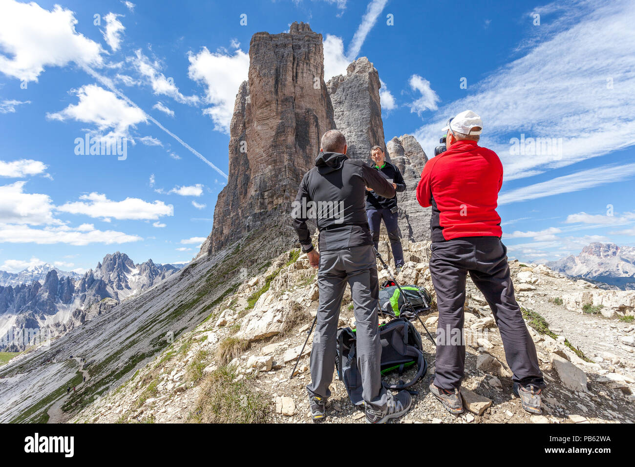 AURONZO DI CADORE, ITALY - JUNE 26, 2018: Cameramen and journalists filming a documentary about Tre Cime di Lavaredo, Dolomites - Stock Image