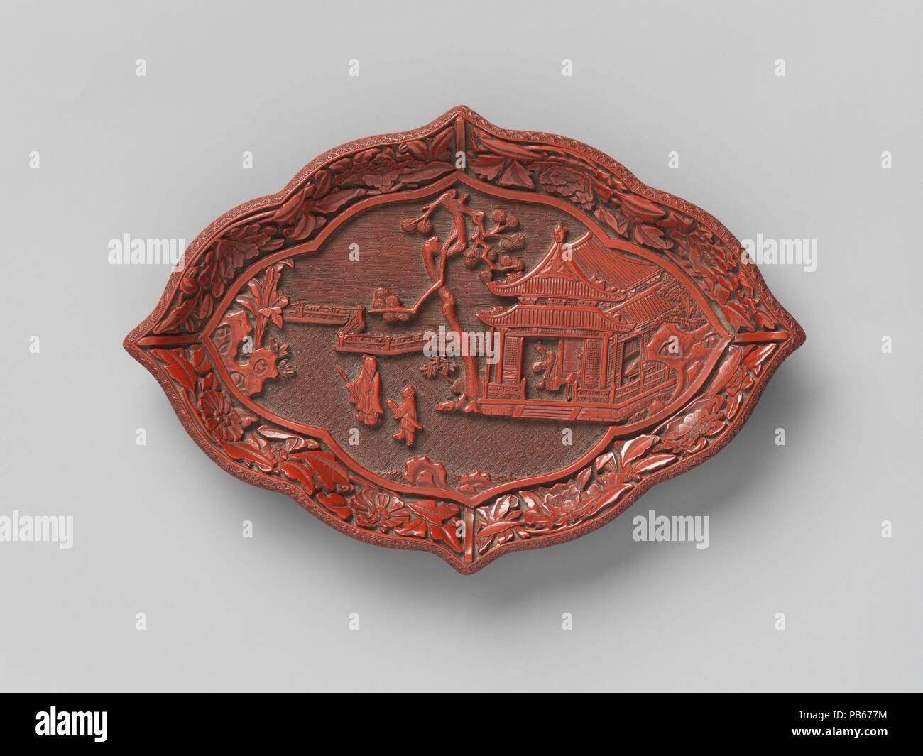 Lozenge-shaped dish with garden scene. Culture: China. Dimensions: H. 7/8 in. (2.2 cm); W. 5 3/8 in. (13.7 cm); L. 7 7/8 in. (20 cm). Date: 14th century.  A scholar-gentleman walks with an attendant, who is holding a zither (a stringed instrument), as they leave another figure in a nearby pavilion. They are either coming from or going to a festive event that would have included music, painting, poetry, and wine. Museum: Metropolitan Museum of Art, New York, USA. - Stock Image