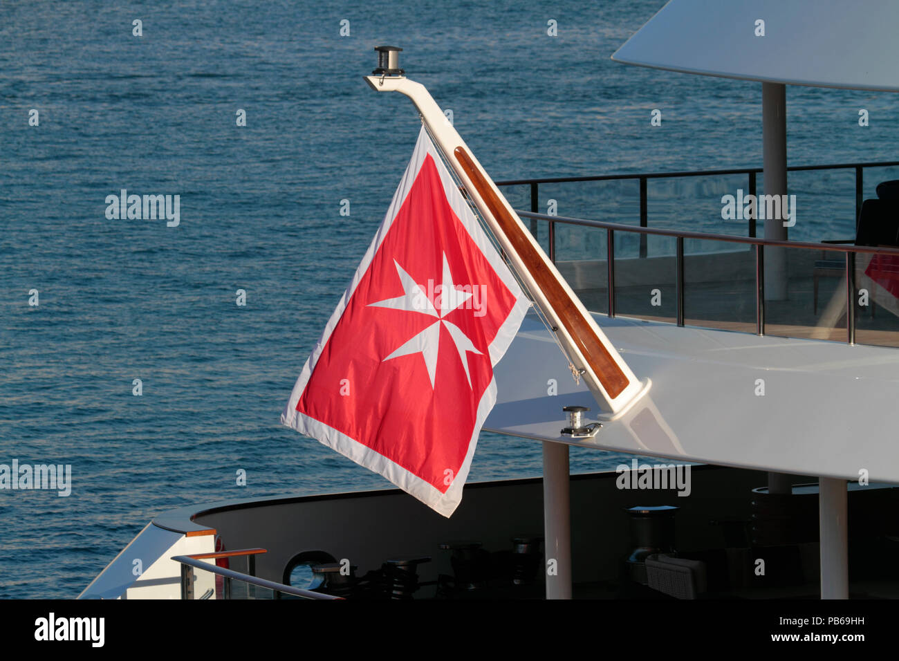 The merchant flag or civil ensign of Malta on the stern of a ship. Malta's maritime shipping register is one of the largest in the EU. - Stock Image