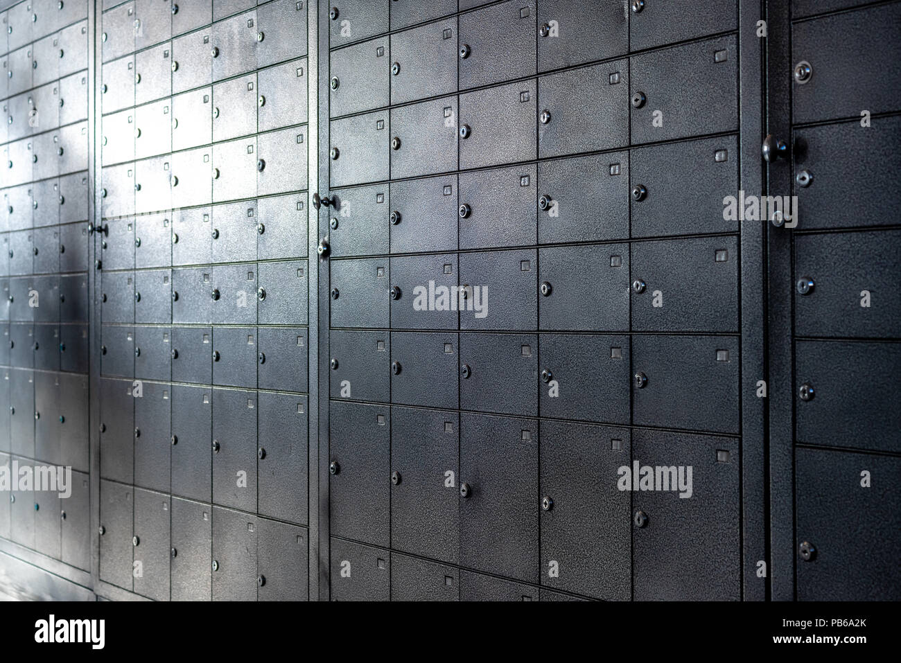 a large number of metal subscriber mail boxes - Stock Image