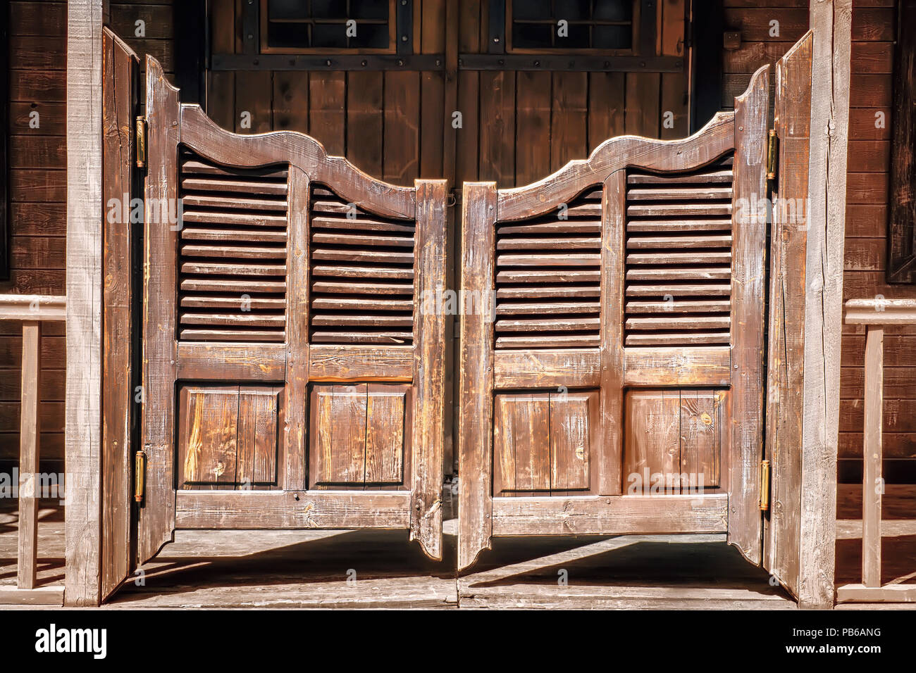 Old saloon entrance with swinging doors - Old Saloon Entrance With Swinging Doors Stock Photo: 213425788 - Alamy