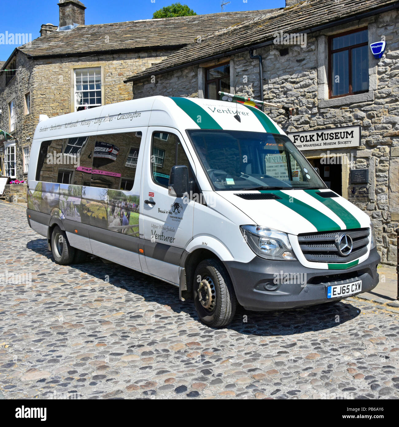 Grassington bus stop Venturer minibus serves Buckden Starbotton Kettlewell Kilnsey Long Ashes villages in Upper Wharfedale North Yorkshire England UK - Stock Image