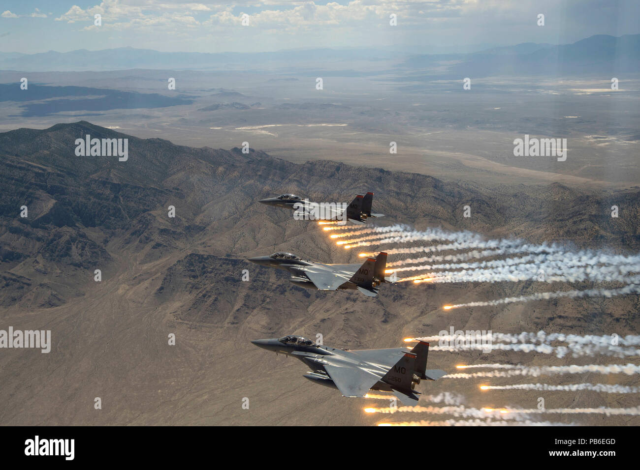 Three U.S. Air Force F-15E Strike Eagles fire flares - Stock Image