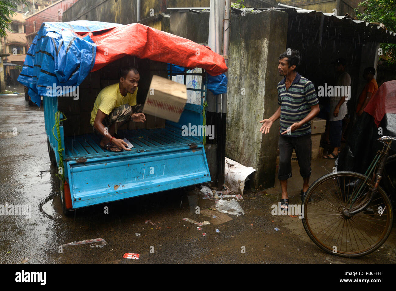 Kolkata, India  26th July, 2018  Indian labor loading goods