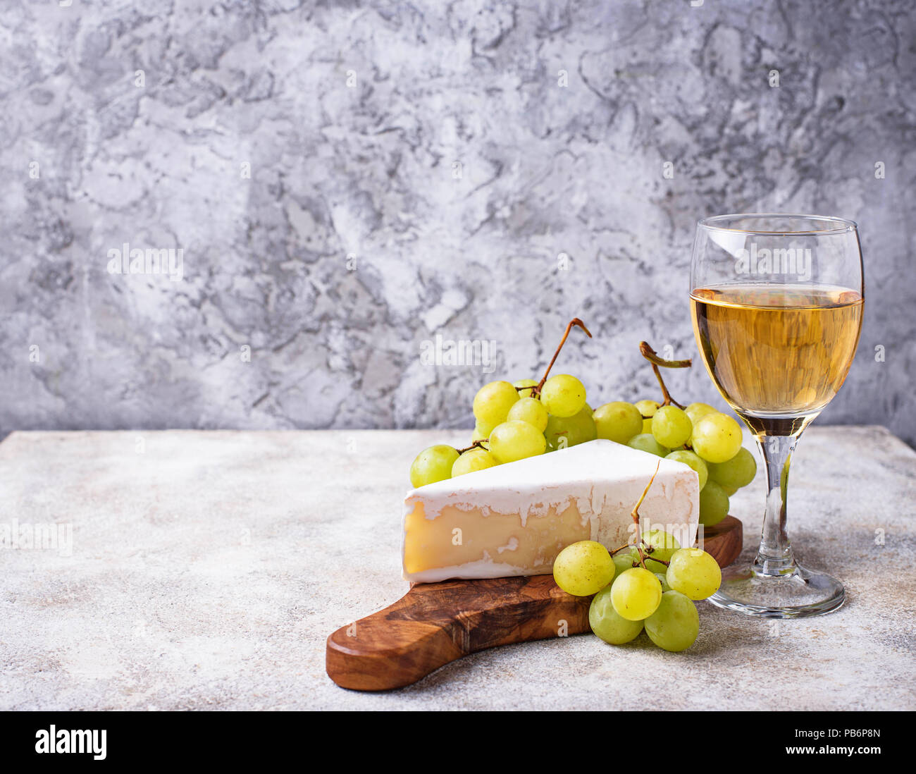 Cheese brie, grape and wine - Stock Image