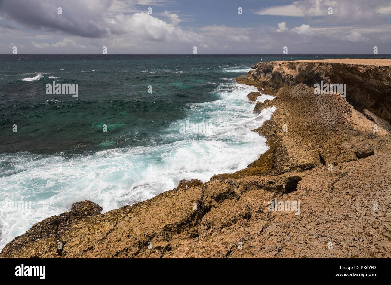 Ocean Waves crashing in the rocky coastline of Arikok National Park, Aruba, Caribbean Stock Photo