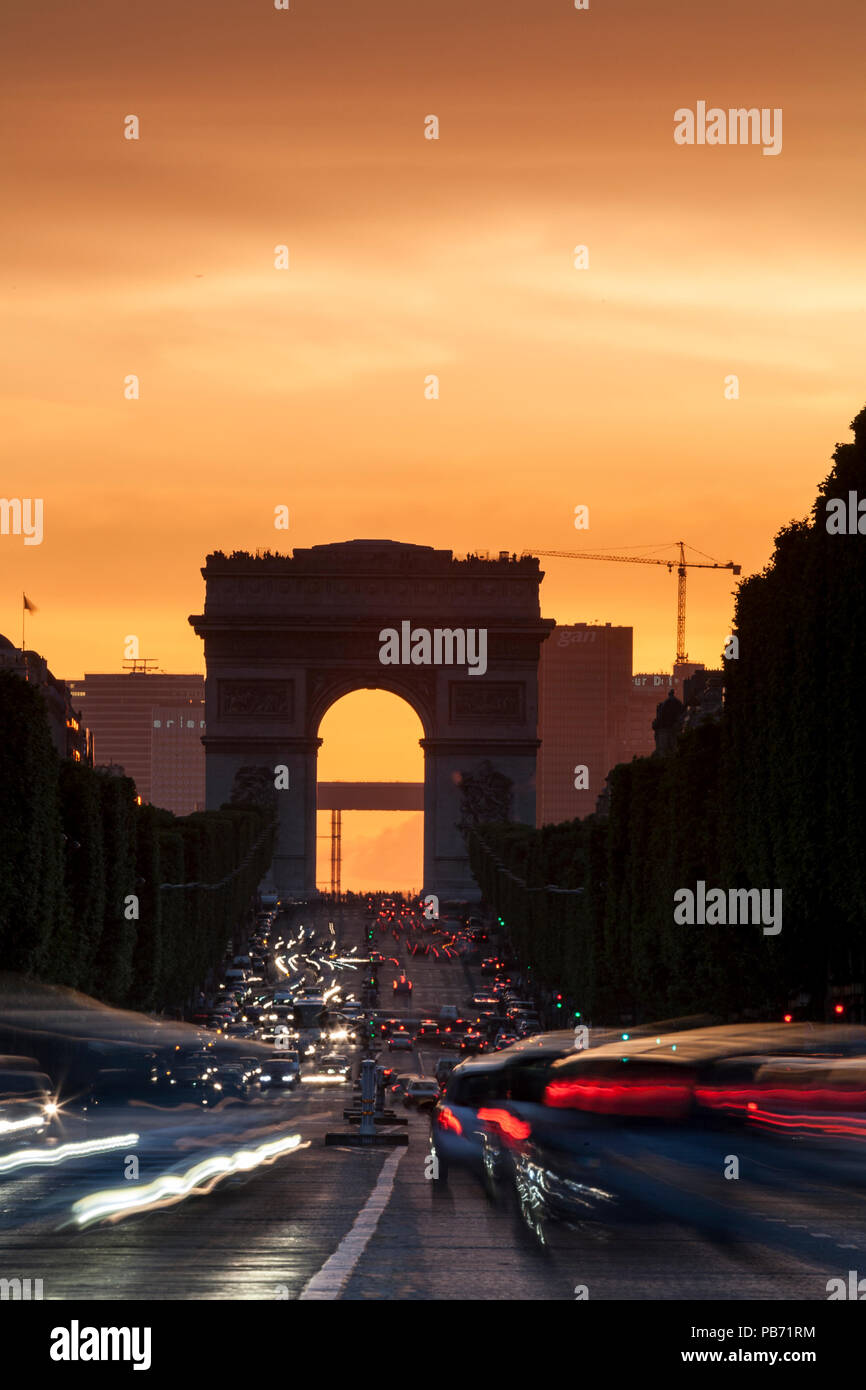 Champs Elysees and Arc de Triomphe at dusk, Paris, France with traffic trails - Stock Image