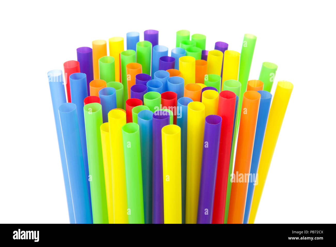 many colorful plastic straws with opening upwards isolated on white background. San Francisco's board of supervisors voted unanimously to join cities  - Stock Image