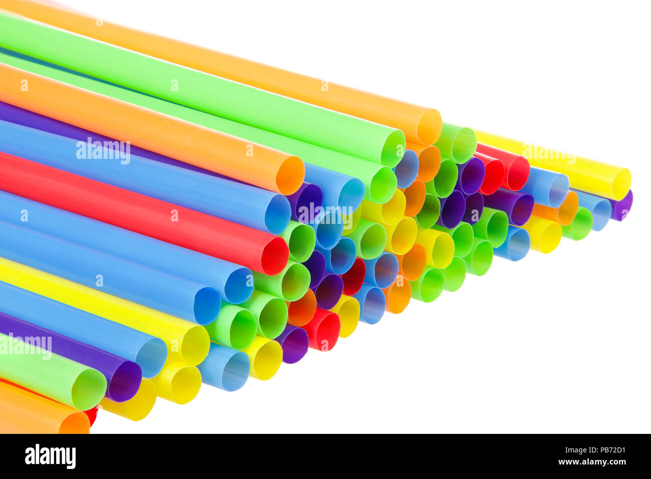 many colorful plastic straws with opening forward isolated on white background. San Francisco's board of supervisors voted unanimously to join cities  - Stock Image