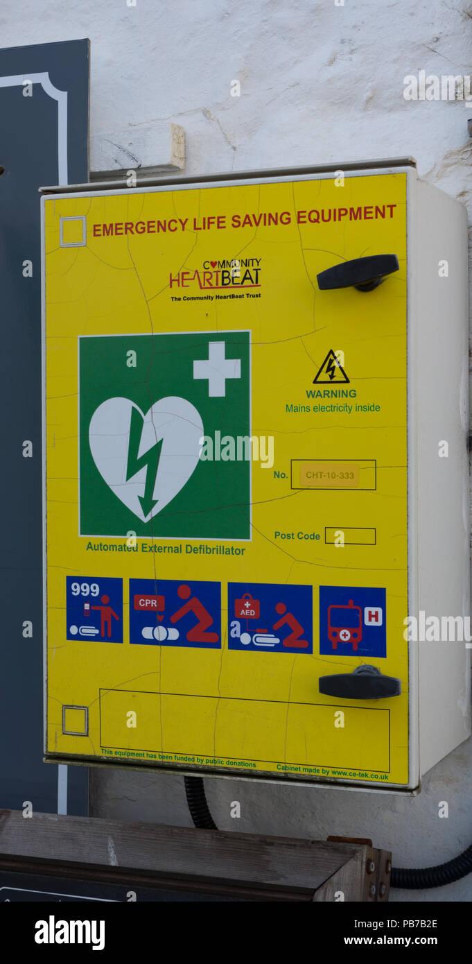 Defibrillator machine on wall. Port Patrick. Scotland - Stock Image