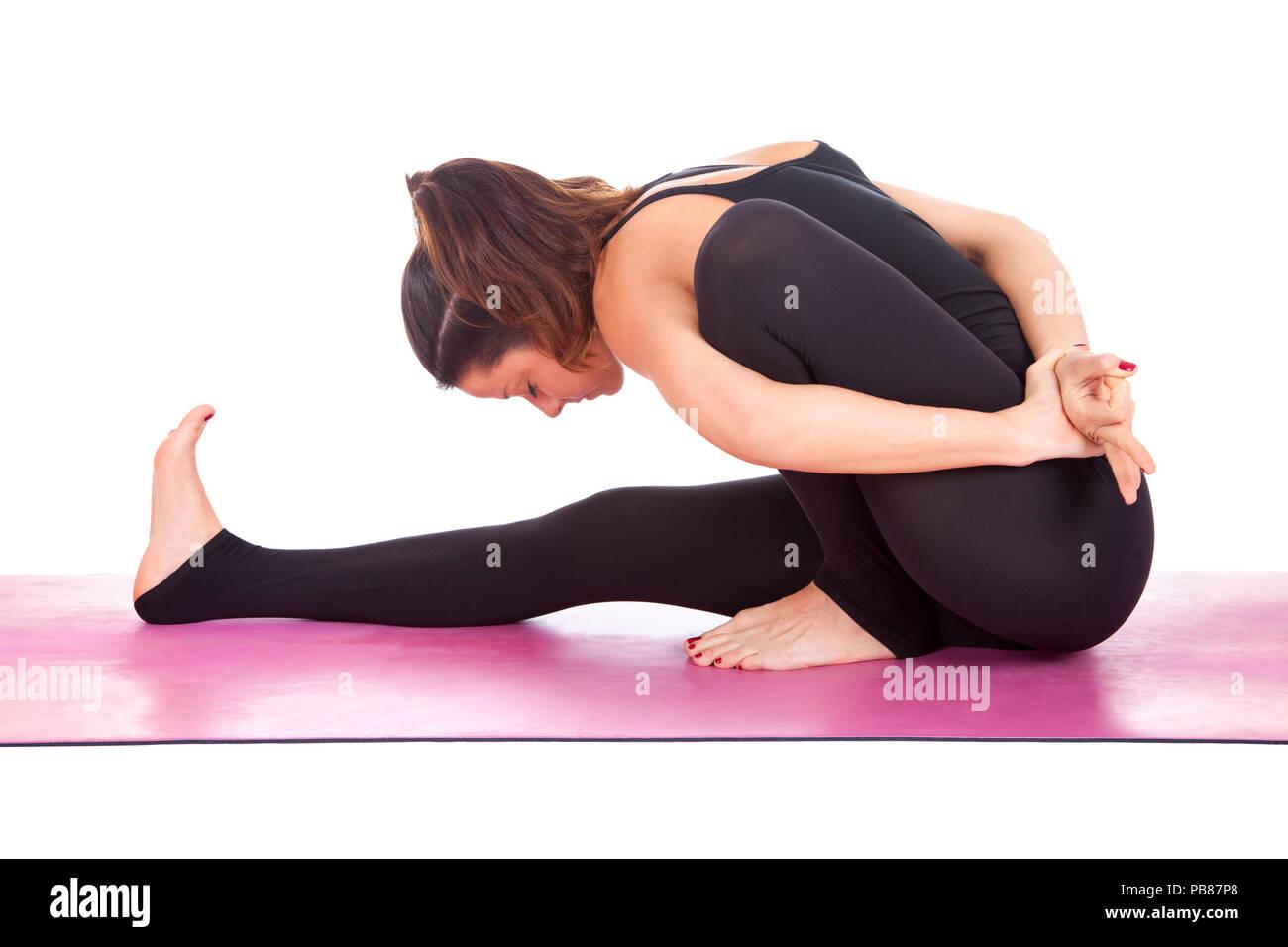 Beautiful Woman Doing Marichyasana Pose On Yoga Class Studio Shot Stock Photo Alamy