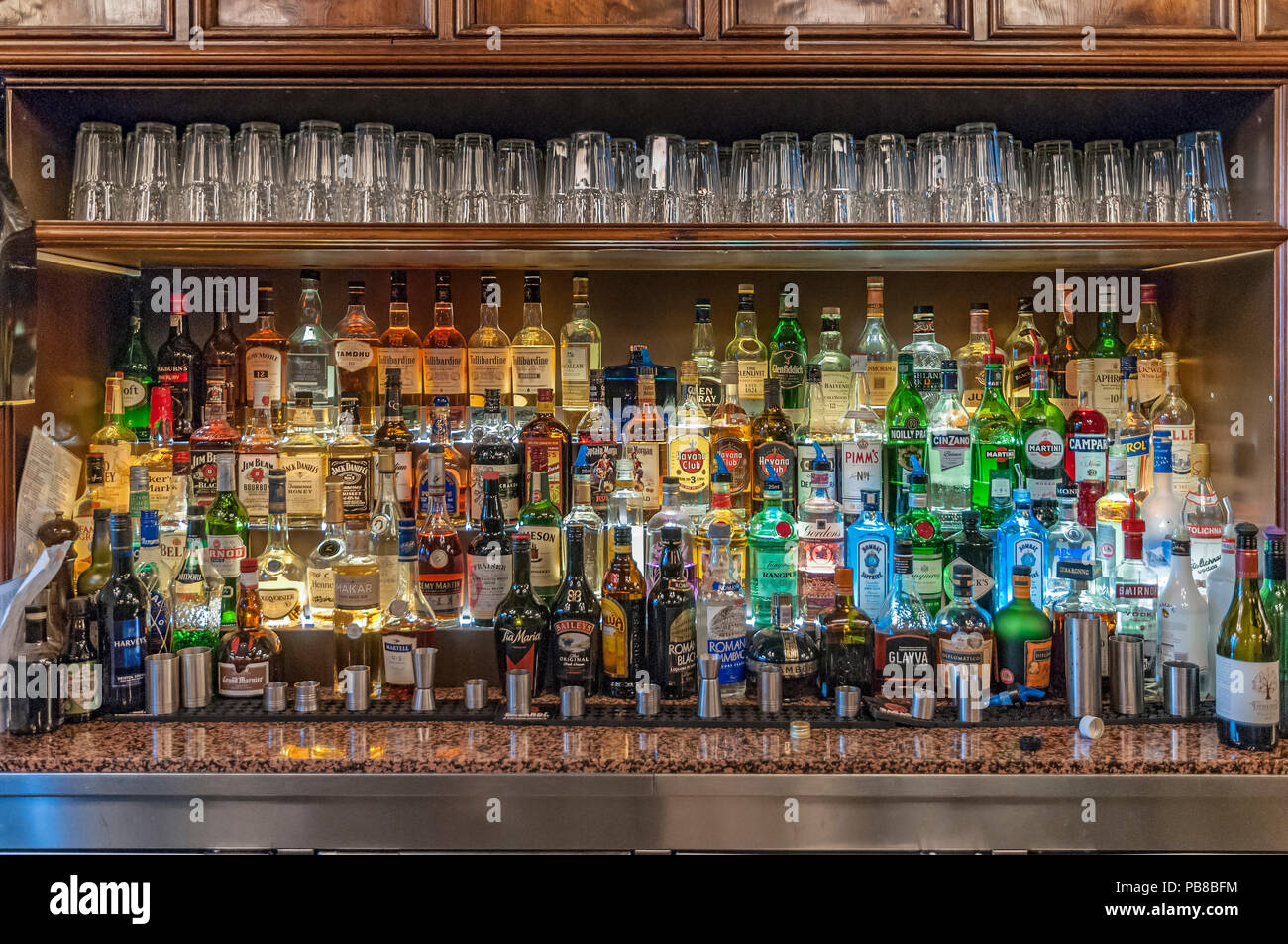 Bar stock of bottles of spirits - Stock Image