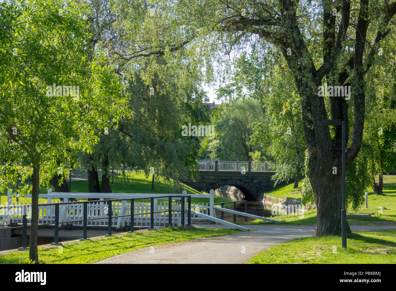 Green park and bridges in Oulu, Finland - Stock Image