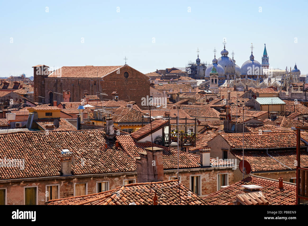 Venice roofs, bricks buildings and San Marco basilica domes in summer, Italy - Stock Image