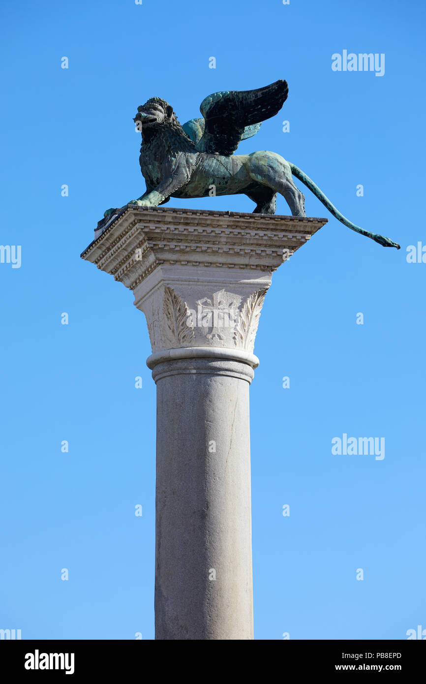 Winged Lion statue, symbol of Venice, clear blue sky in Italy - Stock Image