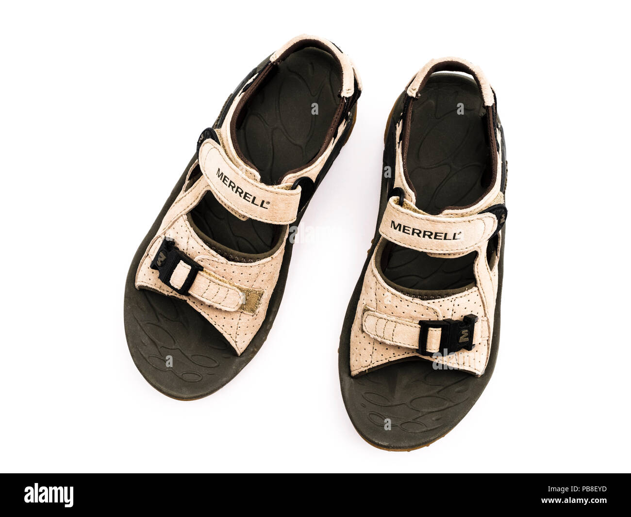A pair of used unisex suede leather Merrell trekking sandals Kahuna lll isolated cut out on a white background from above. England UK Britain - Stock Image