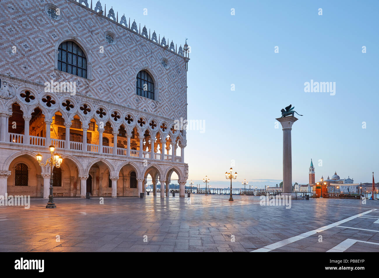 San Marco square with Doge palace and column with lion statue, nobody at sunrise in Venice, Italy - Stock Image