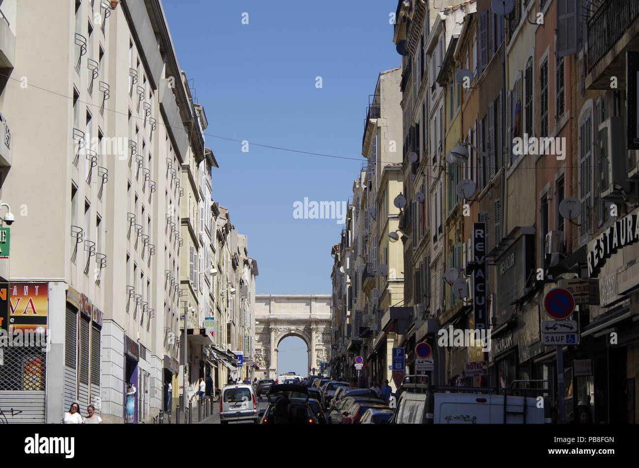 View North up Rue d'Aix to the triumphal arch, known as the Porte Royale or the Porte d'Aix, it commemorates French military victories - Stock Image
