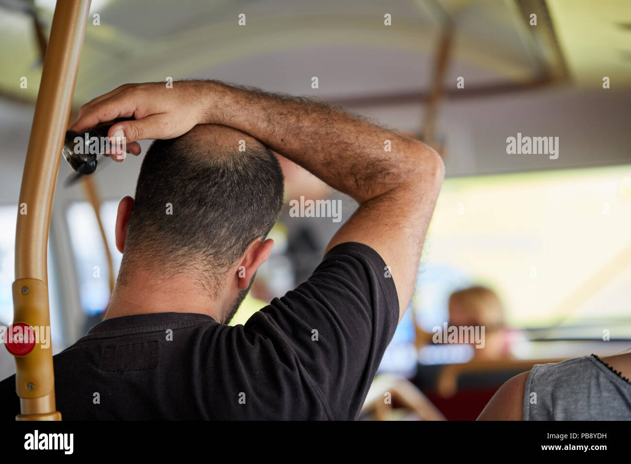 London, UK. 27th July 2018. UK Weather: A passenger on a stifling hot London bus attempting to stay cool on the hottest day of the year. Credit: Kevin Frost/Alamy Live News - Stock Image