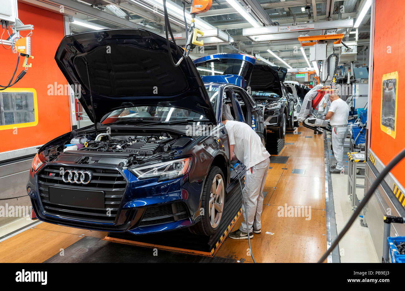 Installation of the front seats on the assembly line of the Audi A3 at the Audi AG plant in Ingolstadt, Bavaria, Germany Stock Photo