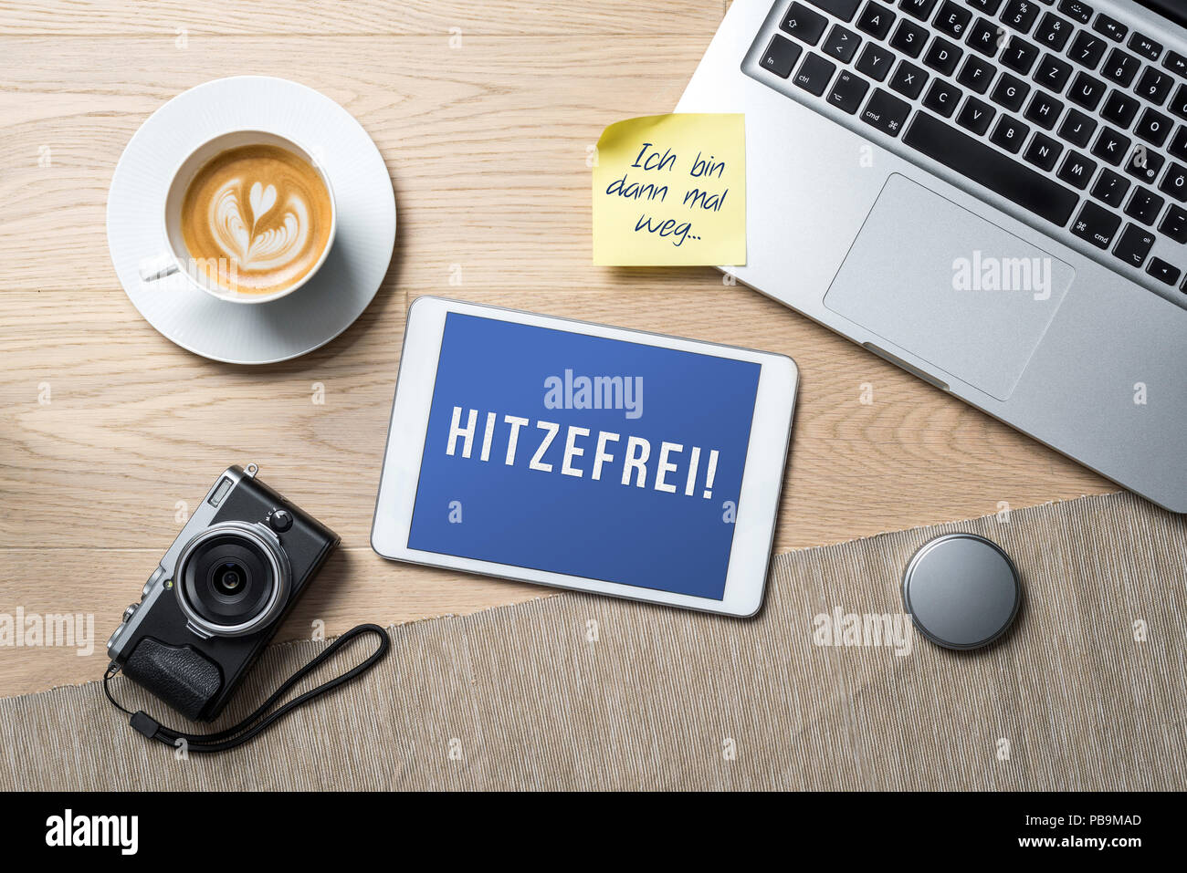 Hitzefrei written in german on tablet meaning having time off from work or school on account of excessively hot weather or heat wave and I'm gone on s - Stock Image