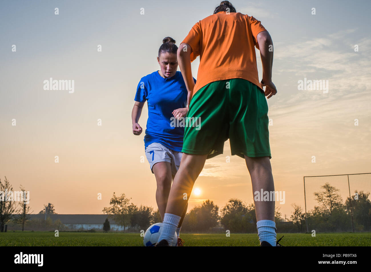 two female soccer players on the field Stock Photo