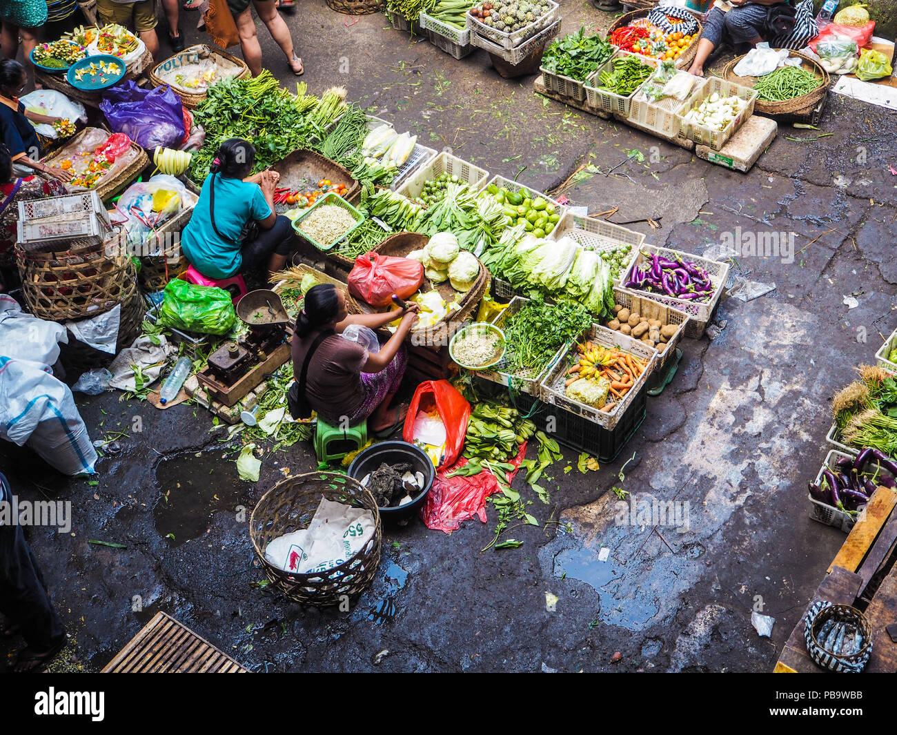 Bali, Indonesia - April 2017: Women selling fresh food at the market in central Ubud - Stock Image