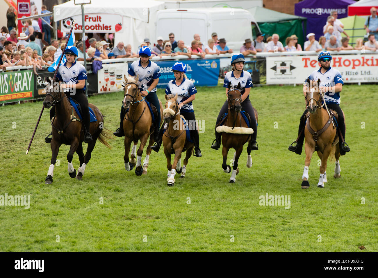 Horse riding display at The Royal Welsh Show, the UK's leading agriculture and farming event, held annually at the purpose built show ground at Builth Wells, Powys, Wales - Stock Image