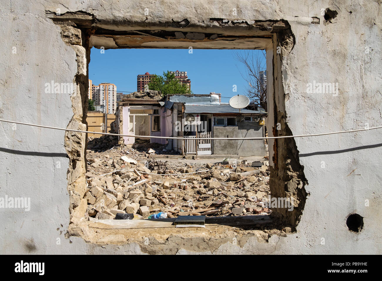 Demolition of an old residential neighbourhood in the city centre of Baku, Azerbaijan to make space for a construction of new bulidings. - Stock Image